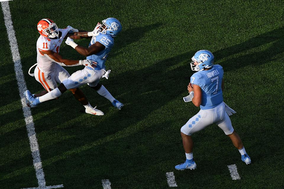 CHAPEL HILL, NC - SEPTEMBER 28: Clemson Tigers linebacker Isaiah Simmons (11) fights to get past North Carolina Tar Heels running back Javonte Williams (25) and get the sack on North Carolina Tar Heels quarterback Sam Howell (7) as he looks to pass in the game between the Clemson Tigers and the North Carolina Tar Heels on September 28, 2019 at Kenen Memorial Stadium in Chapel Hill, NC.(Photo by Dannie Walls/Icon Sportswire via Getty Images)
