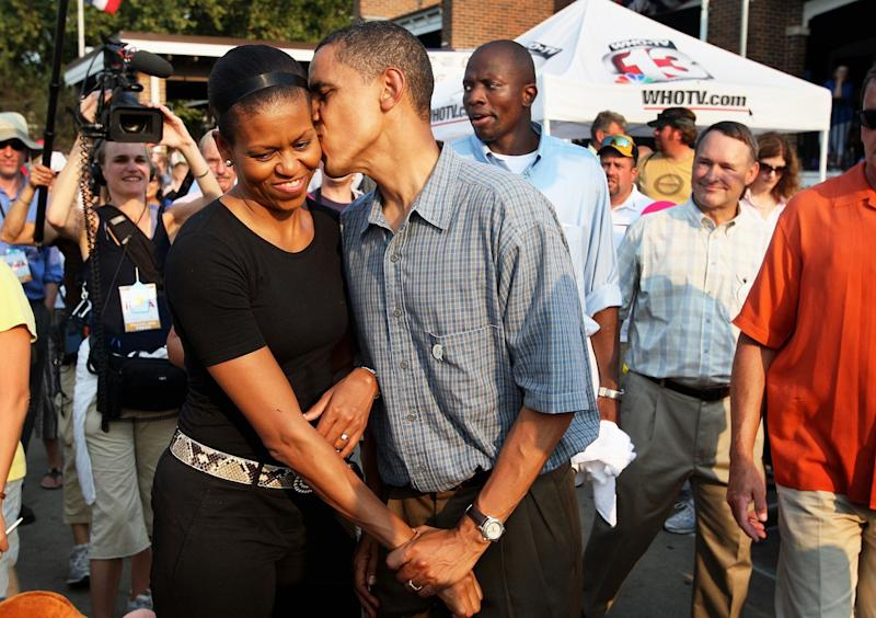 Barack Obama gives his wife Michelle a playful kiss as they tour the Iowa State Fair on Aug. 16, 2007 in Des Moines, Iowa.
