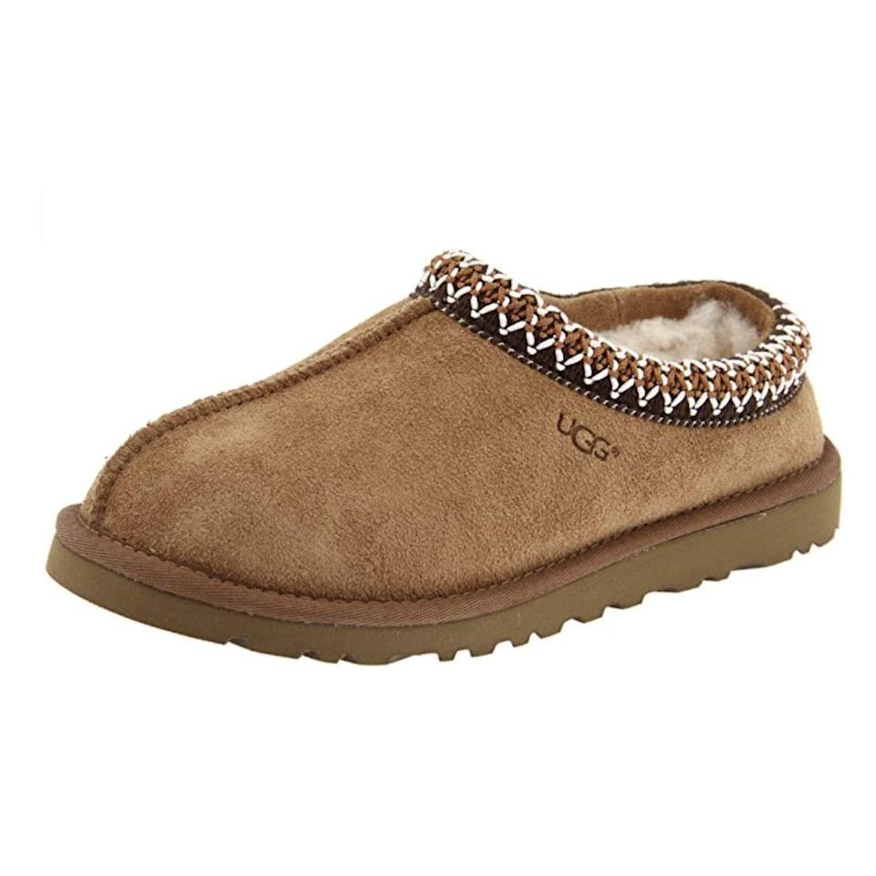 """<p><strong>UGG</strong></p><p>amazon.com</p><p><strong>$99.95</strong></p><p><a href=""""https://www.amazon.com/dp/B000J13YSA?tag=syn-yahoo-20&ascsubtag=%5Bartid%7C10063.g.34680247%5Bsrc%7Cyahoo-us"""" rel=""""nofollow noopener"""" target=""""_blank"""" data-ylk=""""slk:Shop Now"""" class=""""link rapid-noclick-resp"""">Shop Now</a></p><p>There are two types of slippers: UGGs, and everything else. With a sole strong enough to take outdoors, the Tasman is lined with wool with a suede exterior. Feeling like you're walking on clouds, you're never going to want to take them off. The factory that they're made in supports women with HERproject, a partnership with brands to inspire and mentor women in corporate settings. </p>"""