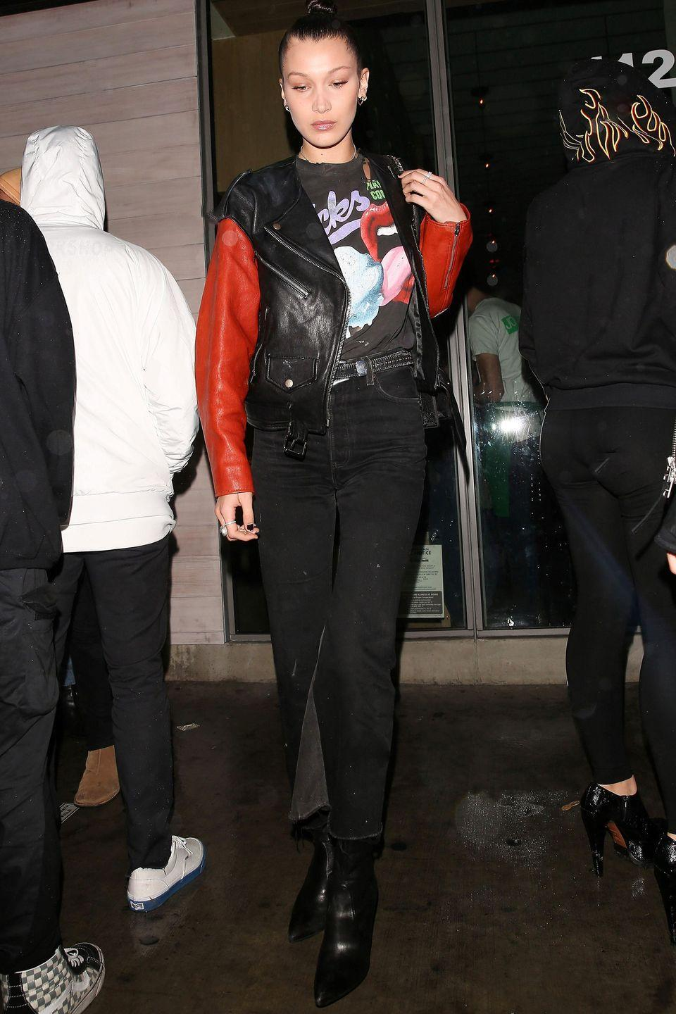 <p>In a black and red leather motorcycle jacket, black high-waisted jeans and black ankle boots while out for dinner at Jon & Vinny's in Los Angeles.</p>