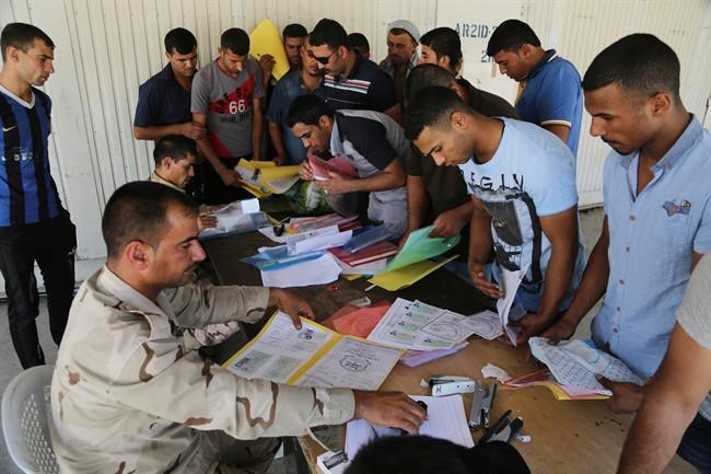 Iraqi security forces find 53 blindfolded bodies south of Baghdad