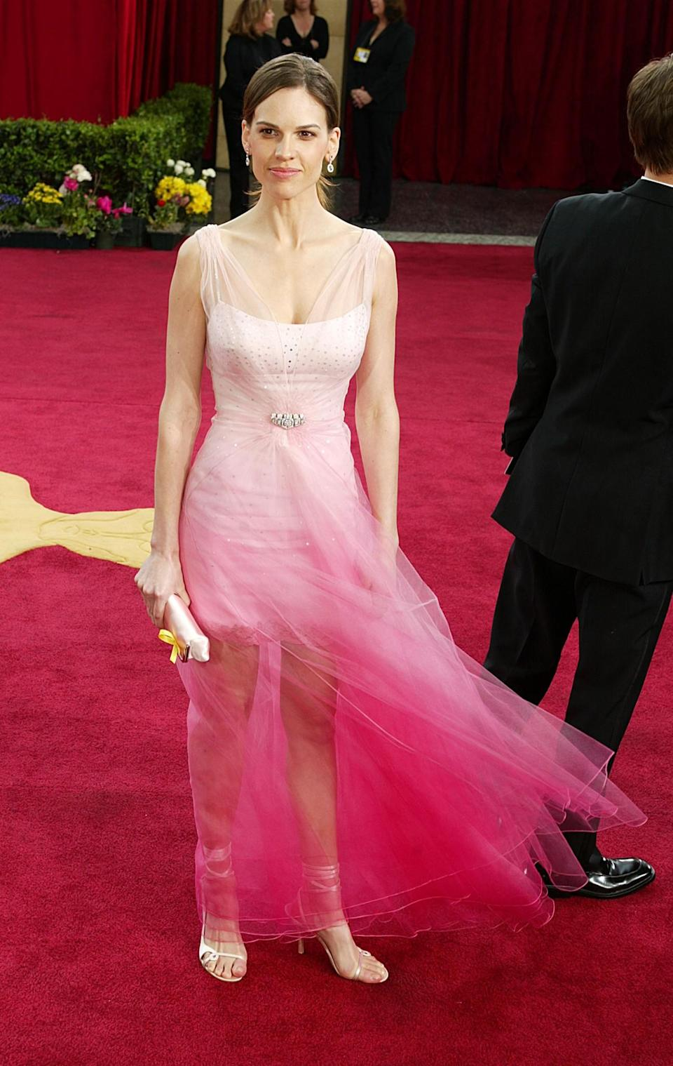 <p>Everything seems to be going fine at the top of Swank's dress in 2003, but as you go further down… <em>[Photo: Kevin Winter/Getty]</em> </p>