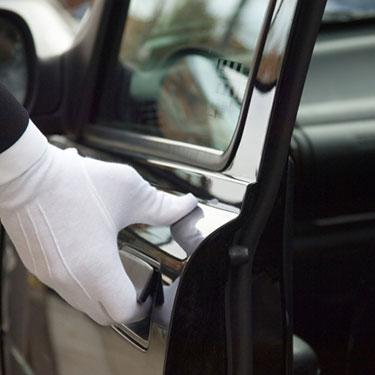 White-formal-gloved-uniformed-hand-opening-car-door_web
