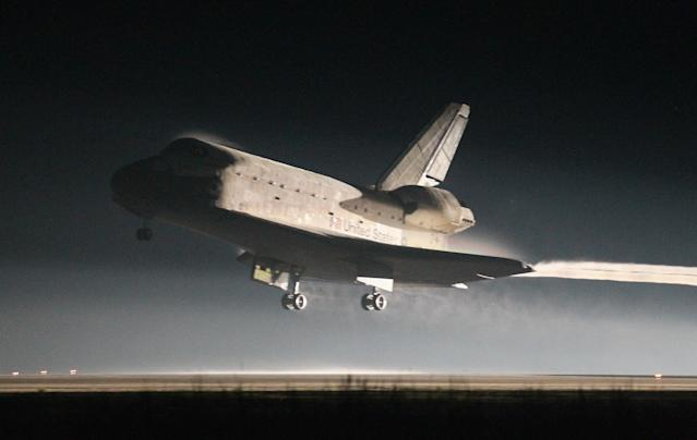 CAPE CANAVERAL, FL - JULY 21: Space Shuttle Atlantis lands at Kennedy Space Center July 21, 2011 in Cape Canaveral, Florida. Atlantis was the shuttle final mission for NASA, ending the 30 years of the shuttle program. (Photo by Joe Raedle/Getty Images)