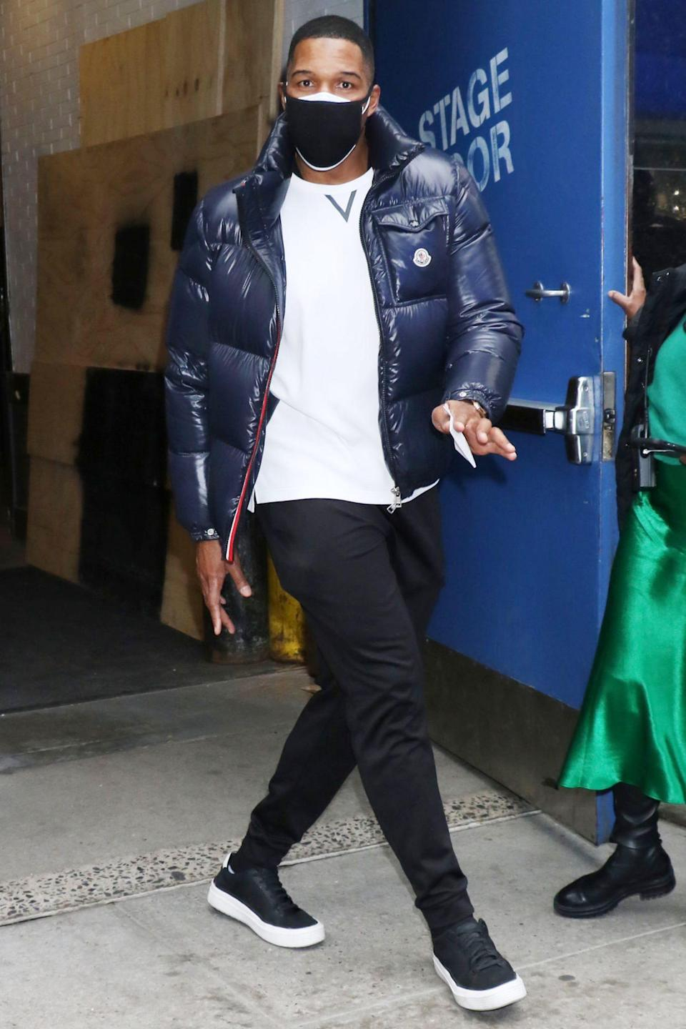 <p>Michael Strahan double masks while out in N.Y.C. on Wednesday.</p>