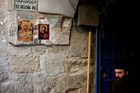 An Orthodox Christian priest walks in the Christian Quarter of Jerusalem's Old City June 21, 2016. REUTERS/Ronen Zvulun