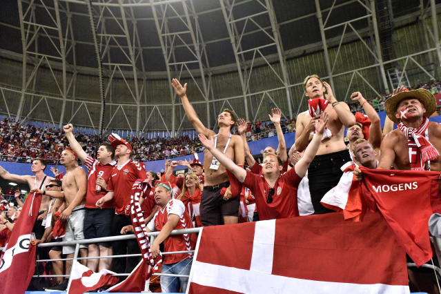 <p>Jubilant: Danish fans celebrate their side's tight win as they go level on points with France at the top of Group C. (AP) </p>