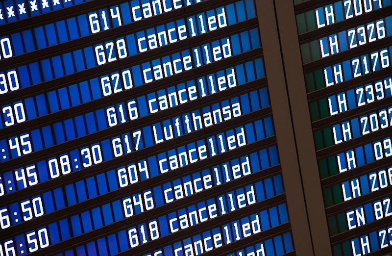 A board displaying flight information at Munich airport in southern Germany, on November 9, 2015 (AFP Photo/Peter Kneffel)