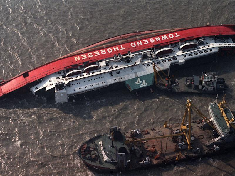 Boats attend the Herald of Free Enterprise the day after the disaster in March 1987. The bow doors had been left open as she left the Belgian port; she capsized so quickly there was no time to send an SOS: AFP