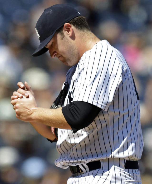 New York Yankees starting pitcher Phil Hughes reacts after allowing a fourth-inning solo home run to Los Angeles Angels' Chris Nelson in a baseball game, Thursday, Aug. 15, 2013, in New York. (AP Photo/Kathy Willens)