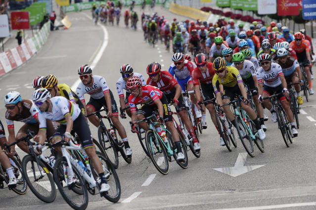 Race leader Primoz Roglic, 6th from left, rides with the pack in the Spanish capital during the La Vuelta cycling race in Madrid, Spain, Sunday, Sept. 15, 2019. (AP Photo/Manu Fernandez)