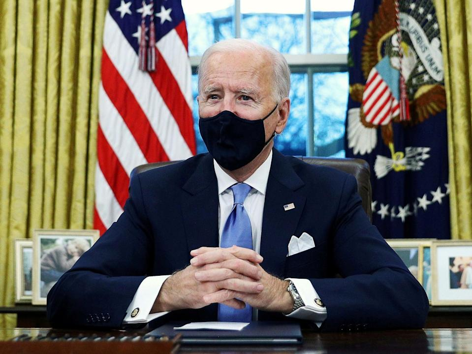 <p>President Joe Biden signs executive orders in the Oval Office of the White House in Washington, after his inauguration as the 46th President of the United States.</p> (REUTERS)