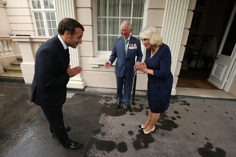 The Prince of Wales and the Duchess of Cornwall greet French president Emmanuel Macron with a namaste gesture at Clarence House in London during his visit to the UK.
