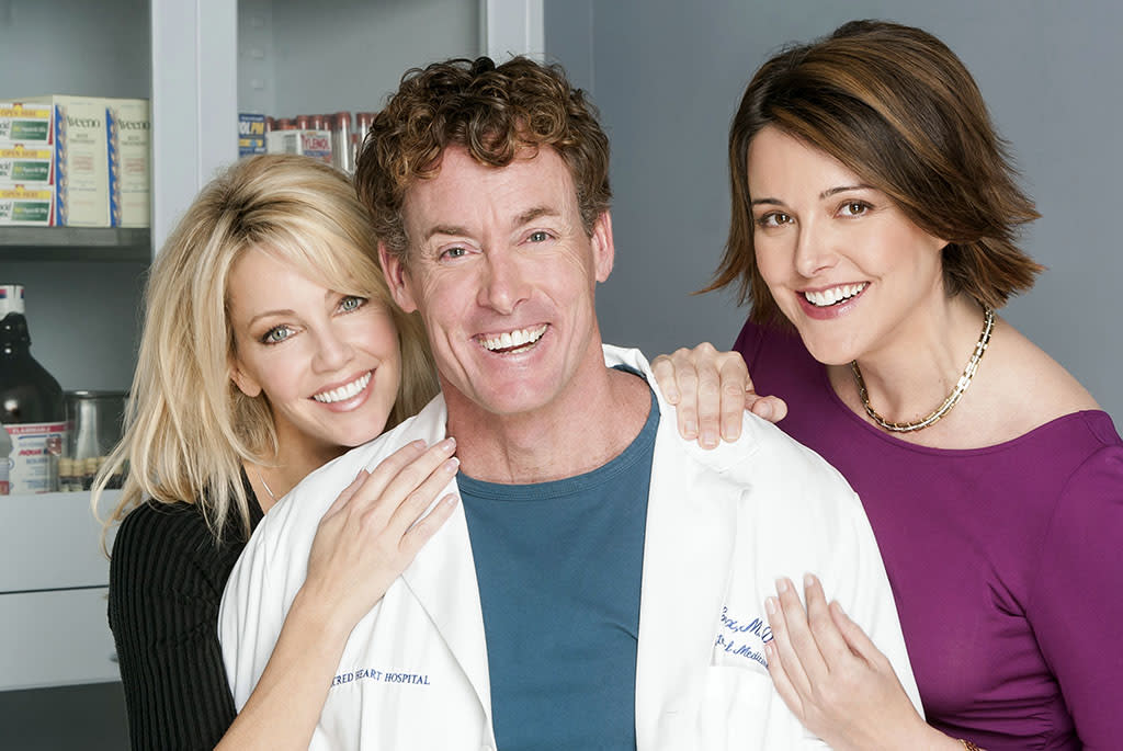 "SCRUBS -- ""My Fruit Cups"" Episode 8 -- Pictured: (l-r) Heather Locklear as Julie Keaton, John C. McGinley as Dr. Perry Cox, Christa Miller as Jordan Sullivan -- (Photo by: Paul Drinkwater/NBC/NBCU Photo Bank via Getty Images)"