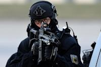 Germany unveiled tough new anti-terror measures after two attacks claimed by the Islamic State group (AFP Photo/Tobias Schwarz )