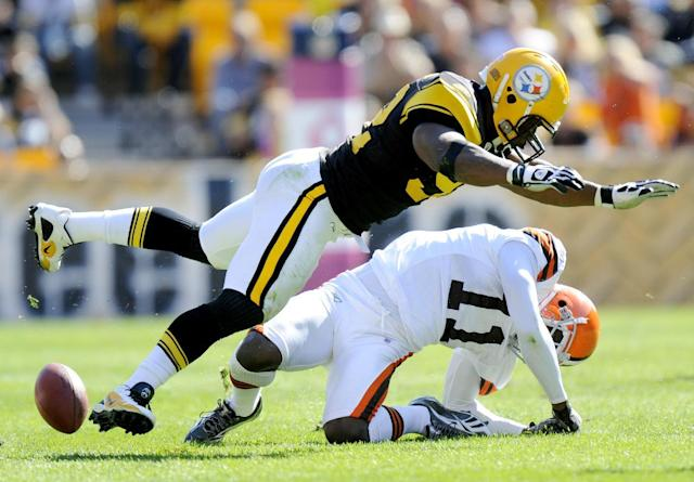 FILE - In this Oct. 17, 2010, file photo, Pittsburgh Steelers linebacker James Harrison (92) hits Cleveland Browns wide receiver Mohamed Massaquoi (11) during the second quarter of a an NFL football game in Pittsburgh. The Steelers released Harrison on Saturday, March 9, 2013, after the team and the hard-hitting defensive star who played on two Super Bowl champions failed to agree on a new contract. (AP Photo/Don Wright, File)