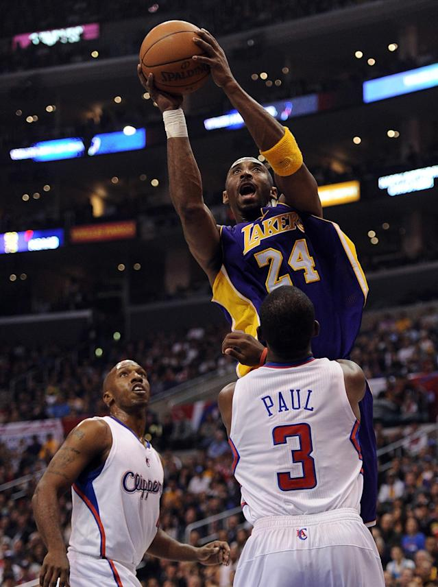 LOS ANGELES, CA - JANUARY 14: Kobe Bryant #24 of the Los Angeles Lakers scores in front of Chris Paul #3 and Chauncey Billups #1 of the Los Angeles Clippers at Staples Center on January 14, 2012 in Los Angeles, California. NOTE TO USER: User expressly acknowledges and agrees that, by downloading and/or using this Photograph, user is consenting to the terms and conditions of the Getty Images License Agreement. (Photo by Harry How/Getty Images)