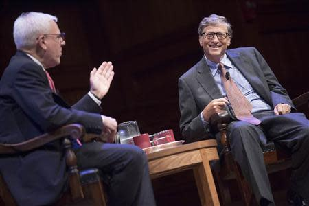 """Handout of campaign o-chair Rubenstein and Gates speaking during """"The Opportunity to Make a Difference"""" at Sanders Theatre at Harvard University in Cambridge"""