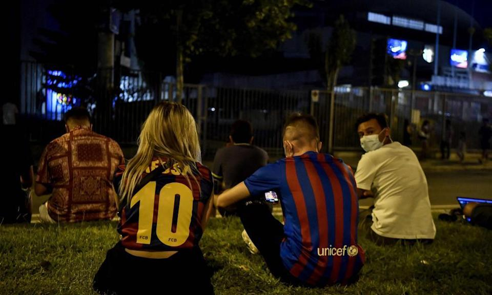 Barcelona fans gather in front of the Camp Nou on Thursday night after hearing that Lionel Messi was leaving the club.