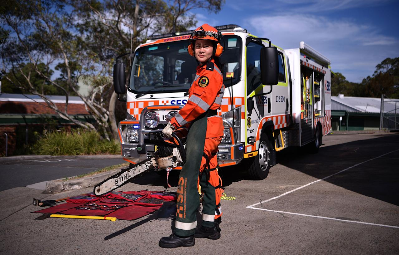 <p>New South Wales state emergency services (SES) volunteer Michelle Whye in uniform in front of an emergency vehicle at the headquarters on February 23, 2018 in Sydney, Australia. (Photo: Peter Parks/AFP/Getty Images) </p>
