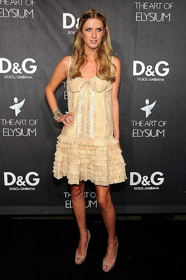 "Nicky Hilton's peach dress was a departure from the sea of black, but it was an odd choice for December and looked too much like lingerie. Jordan Strauss/<a href=""http://www.wireimage.com"" target=""new"">WireImage.com</a> - December 15, 2008"