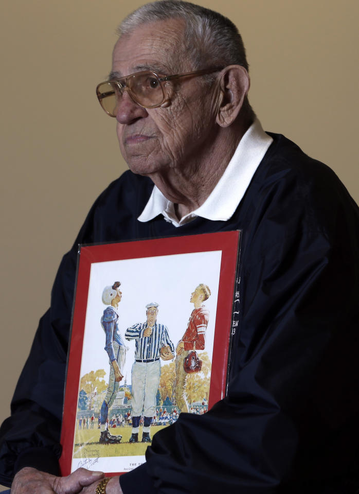 "Butch Corbett of Bennington, Vt., poses with a1950 Saturday Evening Post cover illustration ""The Toss"" by Norman Rockwell for which he modeled at the Bennington Museum on Friday, Sept. 28, 2012, in Bennington, Vt. Corbett is the player on the left. (AP Photo/Mike Groll)"