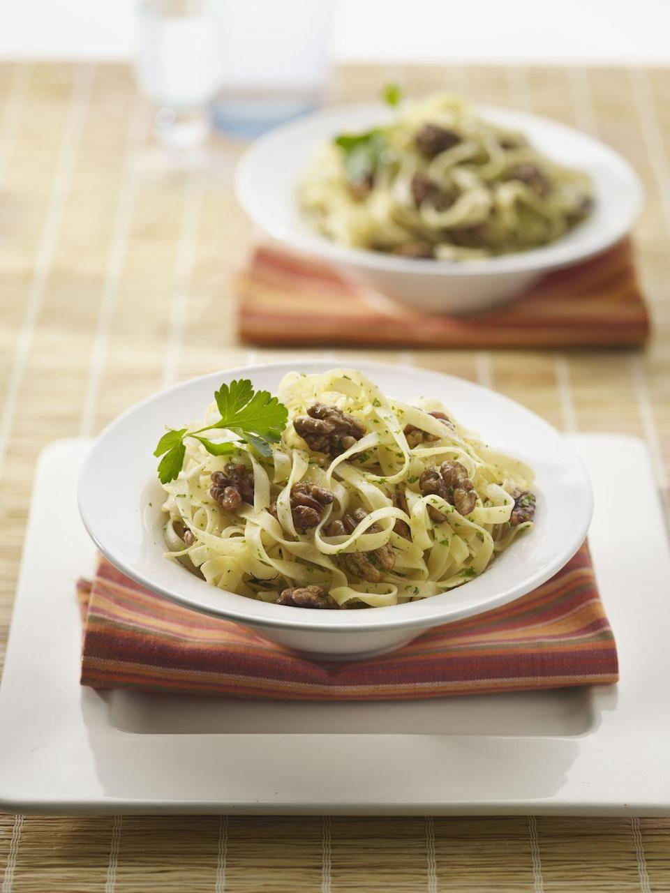 """<p>This decadent dish with toasted walnuts, blue cheese, and fresh chives can be made with rotini, rigatoni, penne, or bow-tie pasta for endless pasta-bilities.</p><p><strong><a href=""""https://www.countryliving.com/food-drinks/recipes/a33200/pasta-with-toasted-walnuts-blue-cheese-and-chives-recipe/"""" rel=""""nofollow noopener"""" target=""""_blank"""" data-ylk=""""slk:Get the recipe."""" class=""""link rapid-noclick-resp"""">Get the recipe.</a></strong></p>"""