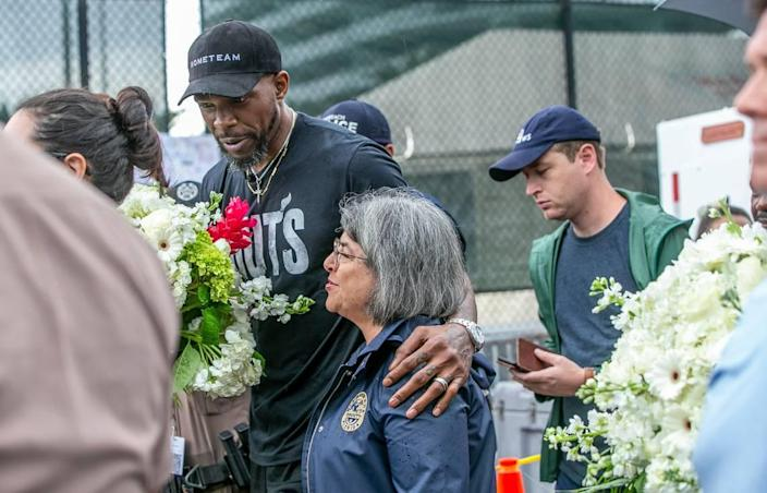 Miamii-Dade County Mayor Daniella Levine Cava and Miami Heat's Udonis Haslem visited the memorial wall for the missing people in the collapsed Champlain Towers South Condo, located at 8777 Collins Avenue in Surfside, on Wednesday, June 30, 2021.