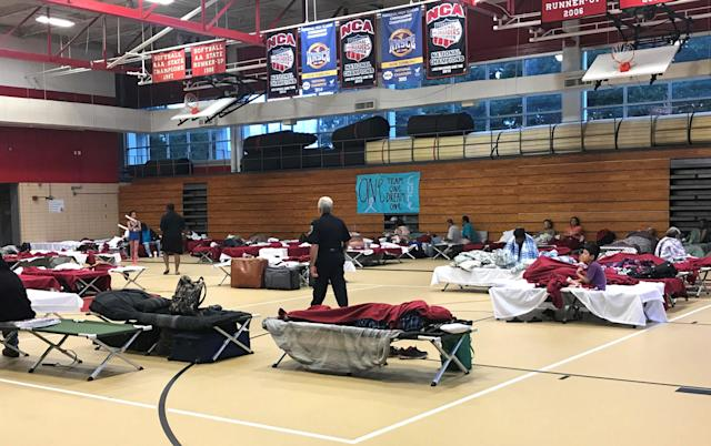 <p>People seen in the hurricane shelter set up in the Belle Chasse High School gym in advance of Hurricane Nate in Belle Chasse, Louisiana, U.S. October 7, 2017. Photo taken October 7, 2017. (Photo: Jessica Resnick-Ault /Reuters) </p>