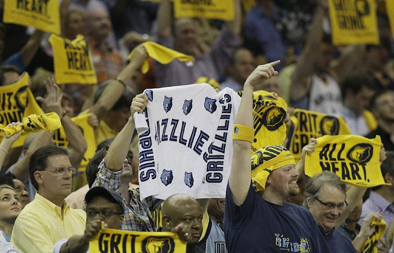 Fans cheer during overtime of Game 4 in a Western Conference semifinal NBA basketball playoff series between the Oklahoma City Thunder and the Memphis Grizzlies in Memphis, Tenn., Monday, May 13, 2013. The Grizzlies defeated the Thunder 103-97 in overtime. AP Photo/Danny Johnston)