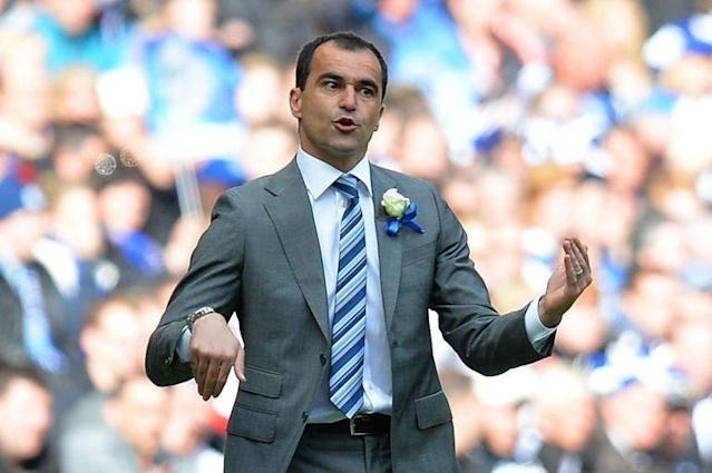 Wigan Athletic's manager Roberto Martinez gestures during the English FA Cup final at Wembley Stadium in London on May 11, 2013. Martinez admitted he was starting to plan for extra-time when Ben Watson scored the goal that sealed one of the great FA Cup final upsets as his underdogs shocked 10-man Manchester City 1-0