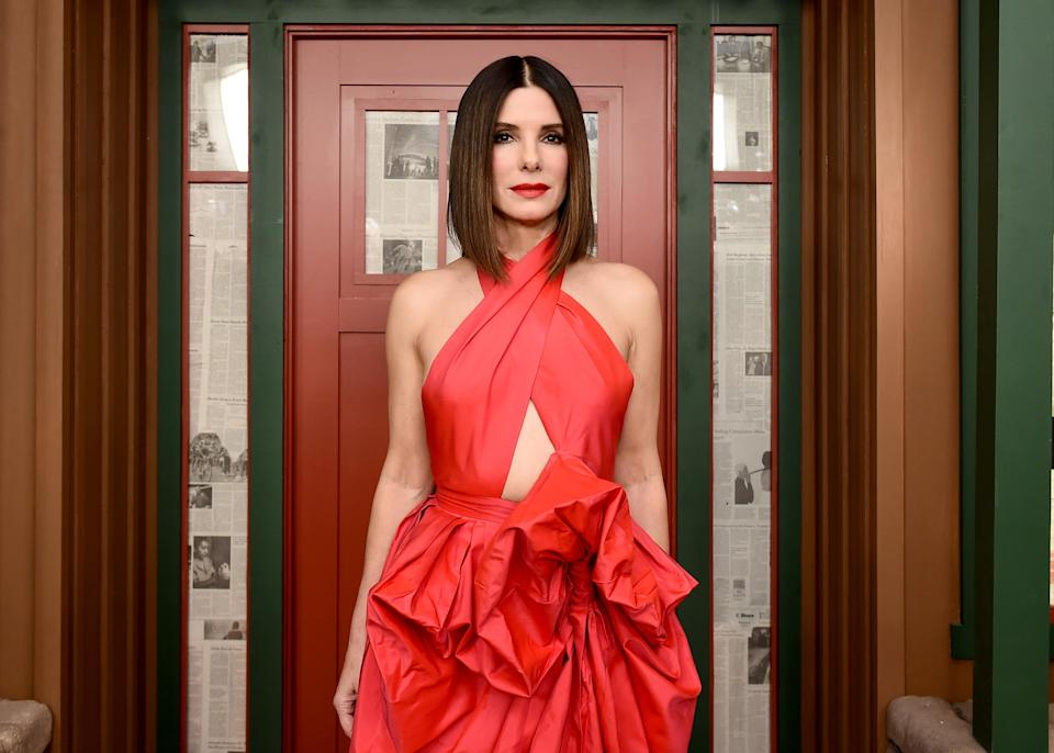 Sandra Bullock looks festive and bright at a special screening of Netflix's<em> Bird Box</em> on Dec. 17 — maybe because she's changed up the way she's doing Christmas this year. Overdoing it is out; giving back is in. (Photo: Getty Images)