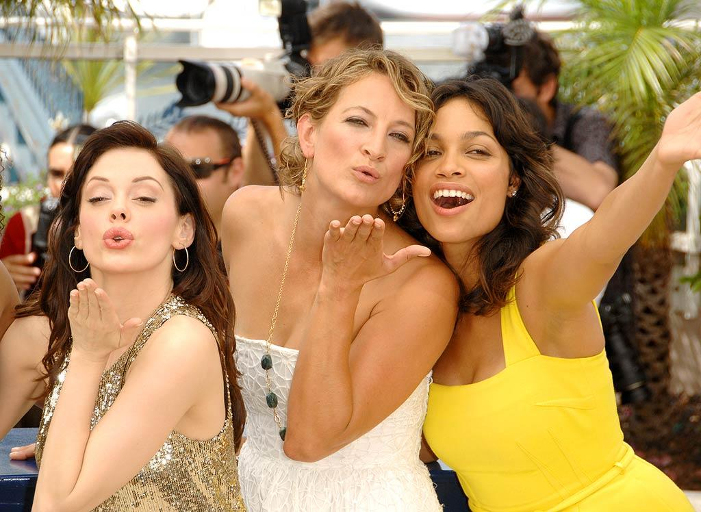 """Grindhouse"" co-stars Rose McGowan, Zoe Bell, and Rosario Dawson blow kisses to the crowd at the Cannes Film Festival. George Pimentel/<a href=""http://www.wireimage.com"" target=""new"">WireImage.com</a> - May 22, 2007"