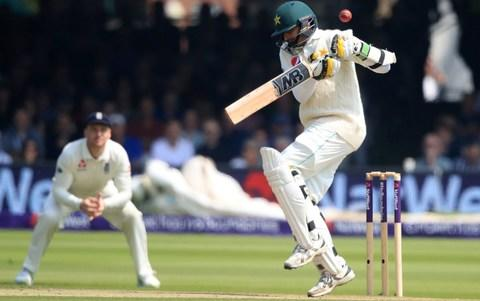 Pakistan's Mohammad Abbas flicks the ball with his glove to get out from England's bowler Mark Wood - Credit: PA