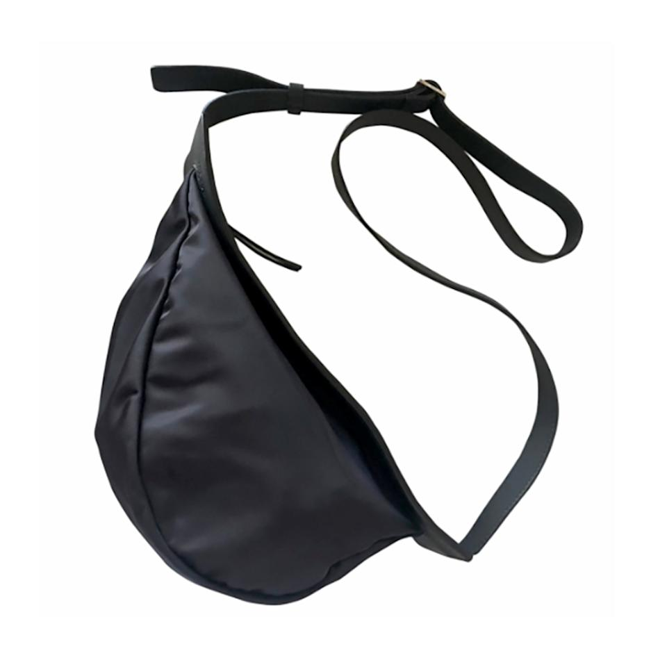 """<p>Vestiaire differs from other resellers as they allow sellers to choose the price of the items they are selling. Once an item is sold it is authenticated by Vestiaire Collective and shipped to the buyer—so you can confidently invest in this banana bag from The Row.</p> <p><strong>Buy now:</strong> The Row, small navy blue nylon banana bag with adjustable shoulder strap, $999, <a href=""""https://us.vestiairecollective.com/women-bags/handbags/the-row/blue-polyester-the-row-handbag-8328666.shtml"""">us.vestiairecollective.com</a>.</p>"""