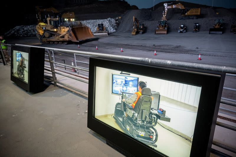 An operator demonstrates using a Cat Command Non-Line of Sight station to operate a dozer at Caterpillar's Construction Industries Europe, Africa and Middle East (EAME) Sales Rally in Malaga