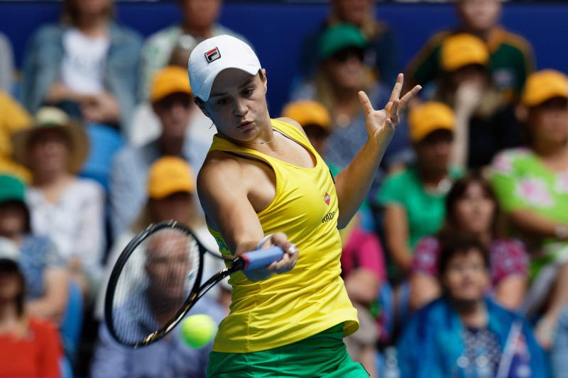 Australia's Ash Barty plays a shot to France's Kristina Mladenovic during their Fed Cup tennis final in Perth, Australia, Sunday, Nov. 10, 2019. (AP Photo/Trevor Collens)