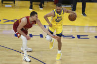 Golden State Warriors' Stephen Curry, right, drives against Denver Nuggets' Nikola Jokic during the first half of an NBA basketball game in San Francisco, Friday, April 23, 2021. (AP Photo/Jed Jacobsohn)