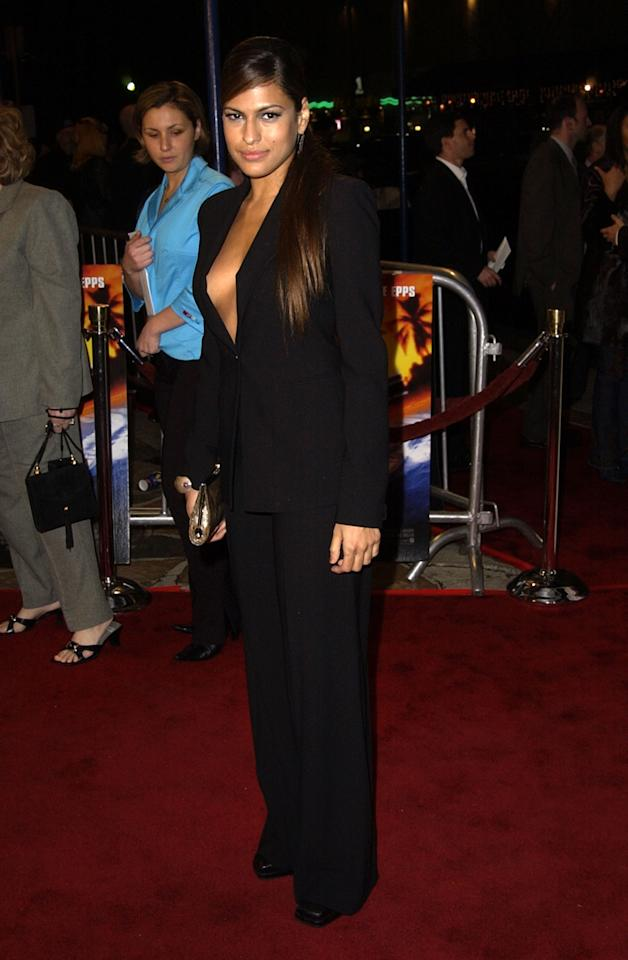 <p>Eva opted for a sexy black menswear inspired look while visiting the Mann Village Theatre in 2002. She completed her look with super long locks.</p>
