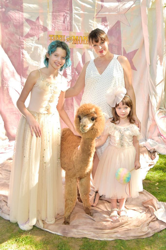 Milla Jovovich welcomed a third daughter in February, pictured here with her older two daughters in October 2019. (Getty Images)