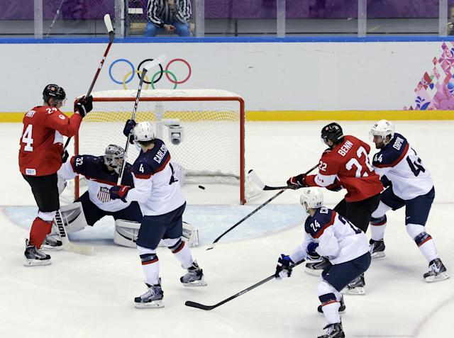 Canada forward Benn Jamie scores a goal during a men's semifinal ice hockey game against the USA at the 2014 Winter Olympics, Friday, Feb. 21, 2014, in Sochi, Russia. (AP Photo/David J. Phillip )