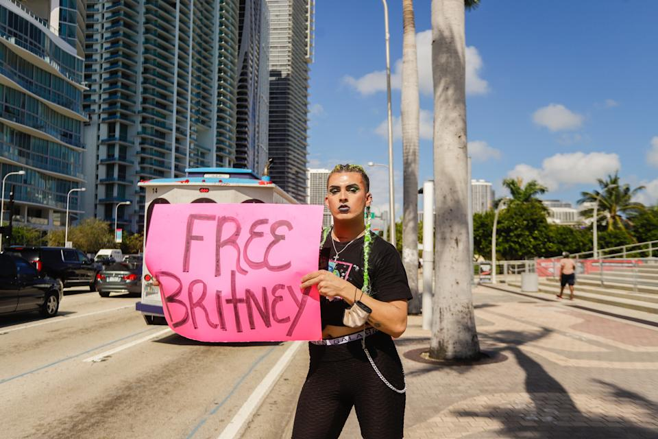 MIAMI, FLORIDA - FEBRUARY 11: A supporter of Britney Spears holds a sign during a #FreeBritney protest outside American Airlines Arena on February 11, 2021 in Miami, Florida. Spears was placed in a conservatorship managed by her father, Jamie Spears, and an attorney, which controls her assets and business dealings, following her involuntary hospitalization for mental care in 2008. (Photo by John Parra/Getty Images)
