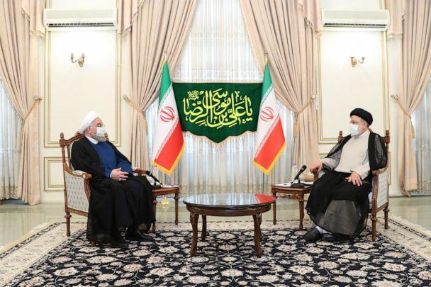 PHOTO: A handout photo made available by the presidential office shows, Iranian president Hassan Rouhani(L) and president-elect Ebrahim Raisi(R) during a meeting in Tehran, Iran, June 19, 2021.  (Iranian Presidency via ZUMA Wire)