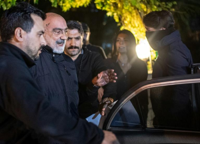 Journalist and writer Ahmet Altan (C) is led to a car by Turkish police after he was detained on November 12 in Istanbul