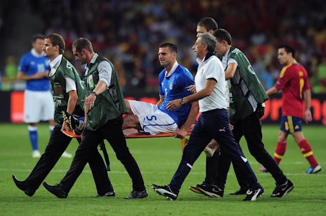 KIEV, UKRAINE - JULY 01: Thiago Motta of Italy is stretchered off the pitch after suffering an injury during the UEFA EURO 2012 final match between Spain and Italy at the Olympic Stadium on July 1, 2012 in Kiev, Ukraine. (Photo by Shaun Botterill/Getty Images)