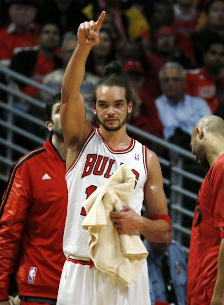 Chicago Bulls center Joakim Noah acknowledges the play of teammates during the second half of Game 3 of their first-round NBA basketball playoff series against the Brooklyn Nets, Thursday, April 25, 2013, in Chicago. The Bulls won 79-76. (AP Photo/Charles Rex Arbogast)