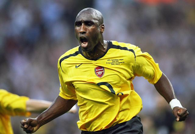 Sol Campbell celebrates after scoring during the UEFA Champion's League final football match Barcelona vs. Arsenal, 17 May 2006 at the Stade de France in Saint-Denis, northern Paris. AFP PHOTO LLUIS GENE (Photo credit: LLUIS GENE/AFP via Getty Images)