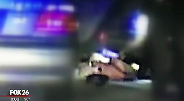 Ms Corley lays on the ground as police conduct their search. Source: Fox 26