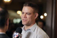 FILE - In this Nov. 13, 2019, file photo, Chicago Cubs president of baseball operations Theo Epstein speaks at a media availability during the Major League Baseball general managers annual meetings in Scottsdale, Ariz. Theo Epstein, who transformed the long-suffering Chicago Cubs and helped bring home a drought-busting championship in 2016, is stepping down after nine seasons as the club's president of baseball operations. The team announced Monday, Nov. 16, 2020, Epstein is leaving the organization, and general manager Jed Hoyer is being promoted to take his place. (AP Photo/Matt York, File)