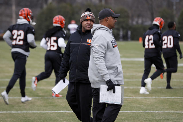 FILE - In this Nov. 14, 2018, file photo, Cincinnati Bengals special assistant Hue Jackson, left, speaks with head coach Marvin Lewis during NFL football practice at Paul Brown Stadium in Cincinnati. Marvin Lewis shut down the question emphatically. The Bengals head coach wont be talking about the newest addition to his staff, one whos in an unusual position to influence the next game. Hue Jackson was the Cleveland Browns head coach less than a month ago. Now hes on the Bengals sideline with Lewis, trying to beat them _ a sensitive subject that the head coach is tried to put off limits on Wednesday. (AP Photo/John Minchillo, File)